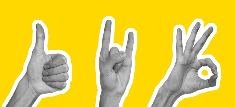 Hands making the thumbs up, rock on, and okay signs in front of a yellow background.